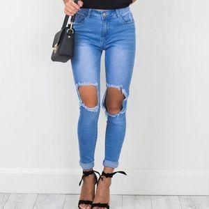 SHOWPO Courts Mid Wash Jeans